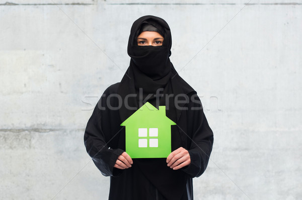 muslim woman in hijab with green house over white Stock photo © dolgachov