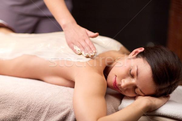 Vrouw Maakt een reservekopie massage spa mensen schoonheid Stockfoto © dolgachov