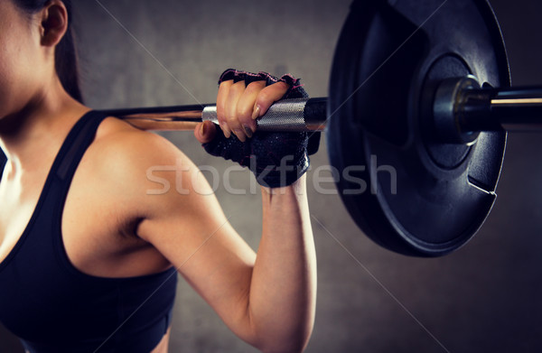 close up of woman with barbell in gym Stock photo © dolgachov