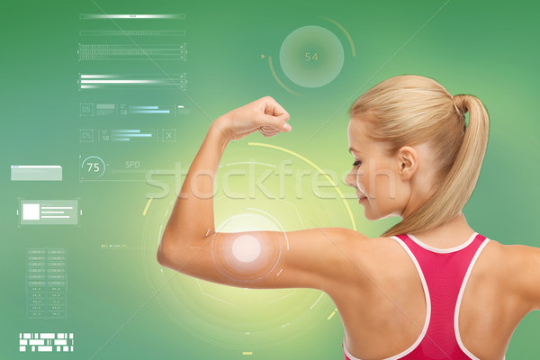 happy sporty woman showing biceps Stock photo © dolgachov
