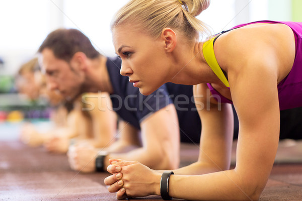 close up of woman at training doing plank in gym Stock photo © dolgachov