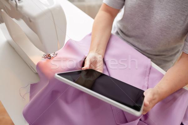 Kleermaker naaimachine weefsel mensen handwerk Stockfoto © dolgachov