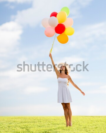 happy woman with helium air balloons in summer Stock photo © dolgachov