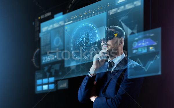 businessman in virtual reality headset and screens Stock photo © dolgachov