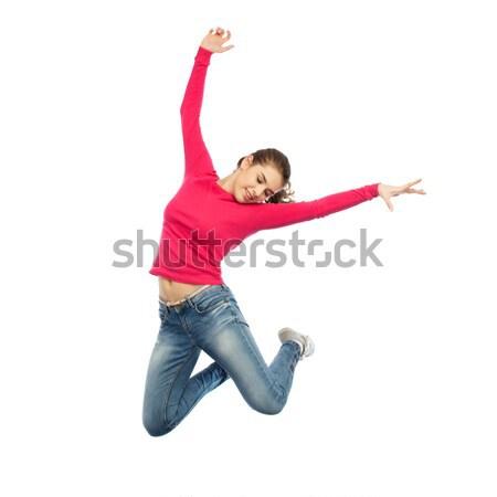 Gelukkig jonge vrouw springen lucht dansen geluk Stockfoto © dolgachov