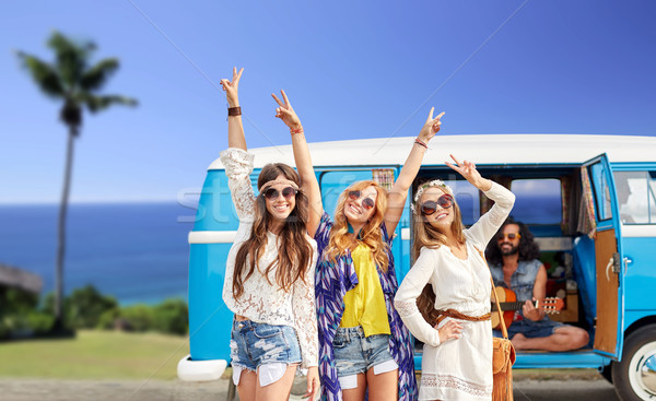 happy hippie friends at minivan car on beach Stock photo © dolgachov