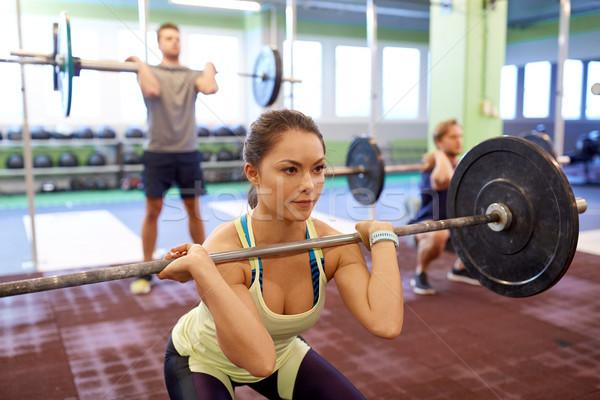 Grup insanlar eğitim spor salonu uygunluk spor egzersiz Stok fotoğraf © dolgachov