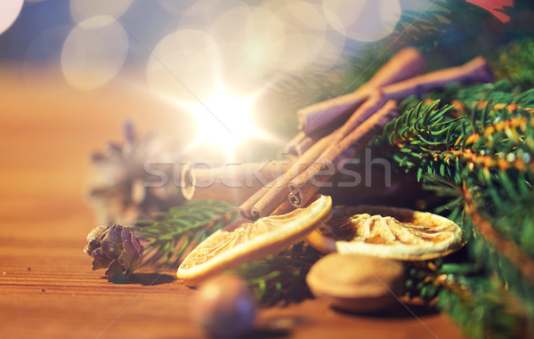 christmas fir branch, cinnamon and dried orange Stock photo © dolgachov