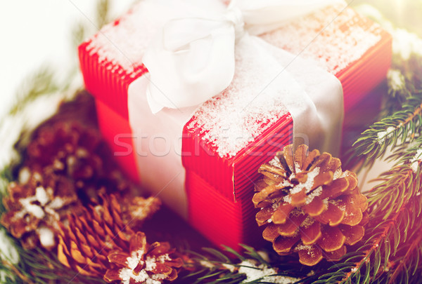 Stock photo: close up of christmas gift and fir wreath on snow