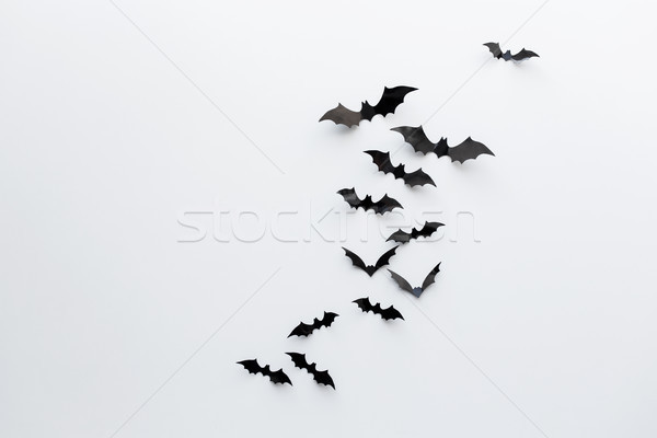 black paper bats over white background Stock photo © dolgachov