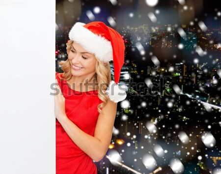 beautiful woman in red dress with christmas gift Stock photo © dolgachov