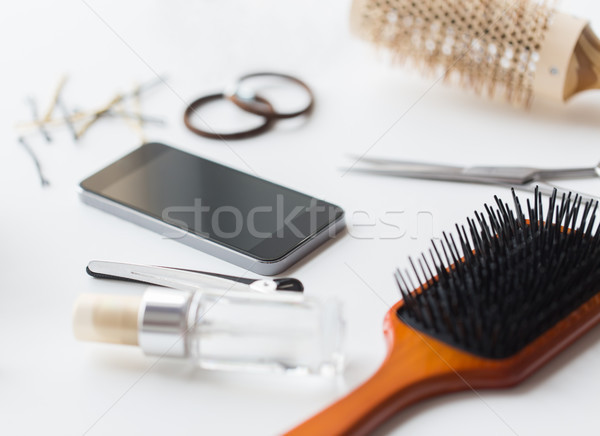smartphone, scissors, brushes and other hair tools Stock photo © dolgachov