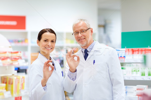 apothecaries at pharmacy showing ok hand sign Stock photo © dolgachov