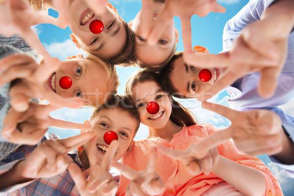 детей мира рукой знак красный носа Сток-фото © dolgachov