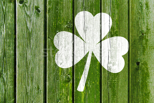 shamrock silhouette on old green wooden boards Stock photo © dolgachov