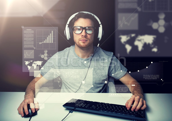 man in headset with computer over virtual screens Stock photo © dolgachov