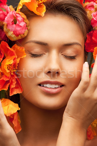 lovely woman with red flowers Stock photo © dolgachov