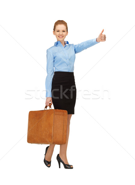 hitch-hiking woman with suitcase Stock photo © dolgachov