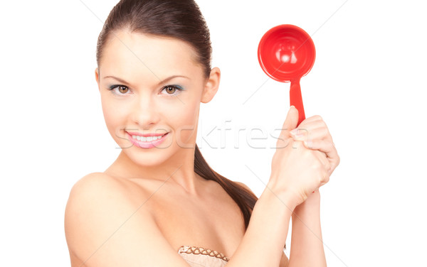 beautiful housewife with red ladle  Stock photo © dolgachov