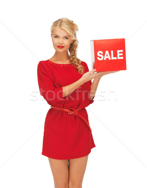 Stock photo: lovely woman in red dress with sale sign