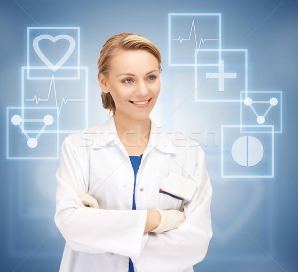 Привлекательная женщина врач ярко фотография девушки счастливым Сток-фото © dolgachov
