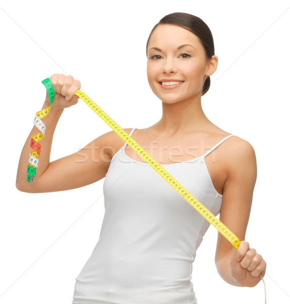 woman measuring her hips Stock photo © dolgachov