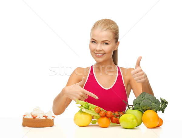 woman pointing at healthy food Stock photo © dolgachov