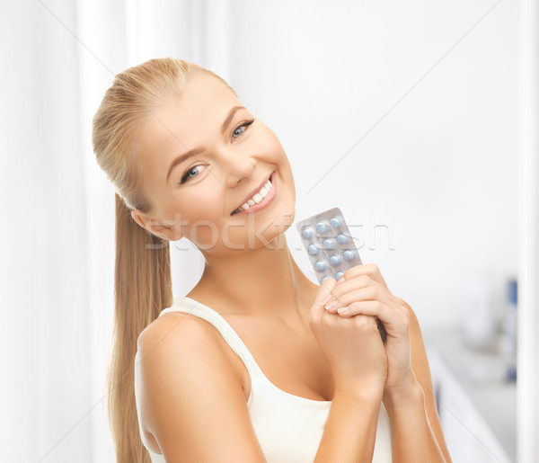 young woman with one pack of pills Stock photo © dolgachov