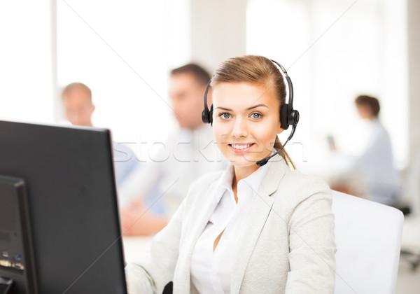 helpline operator with headphones in call centre Stock photo © dolgachov