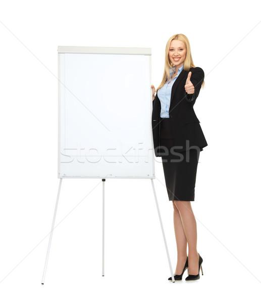 Gülen işkadını beyaz flipchart resim iş Stok fotoğraf © dolgachov