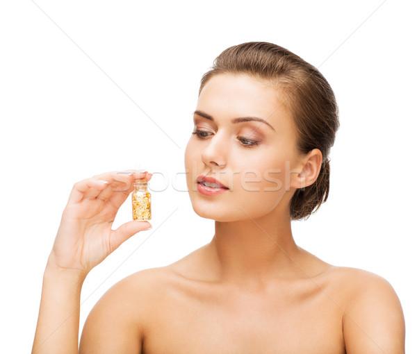 Bela mulher garrafa dourado poeira beleza Foto stock © dolgachov