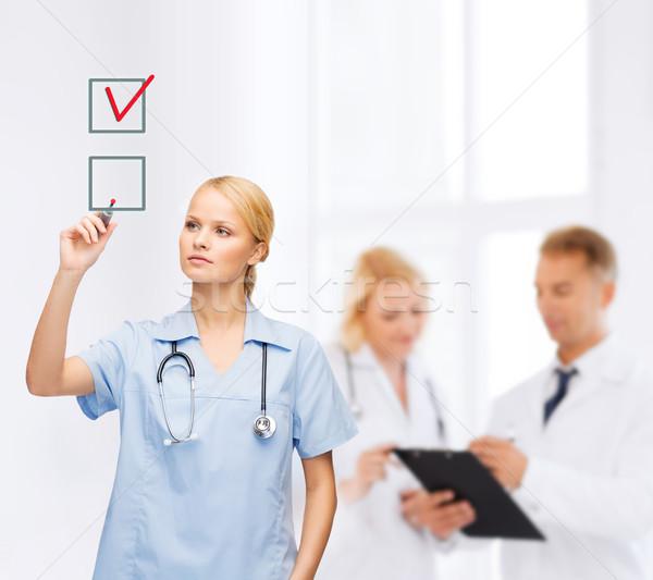 врач медсестры флажок здравоохранения медицинской технологий Сток-фото © dolgachov