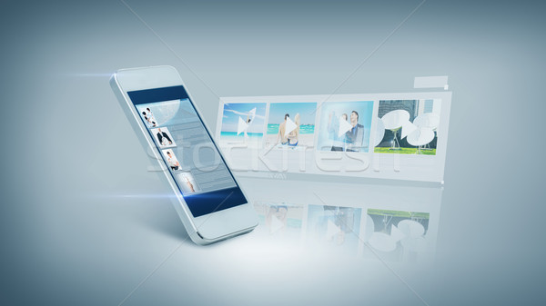 white smarthphone with video on screen Stock photo © dolgachov