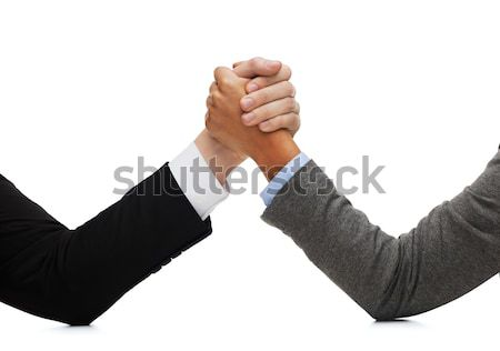 businessman and businesswoman wrestling on table Stock photo © dolgachov