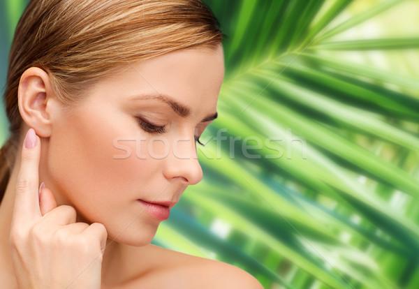 Donna toccare orecchio salute bellezza Foto d'archivio © dolgachov