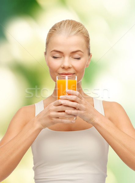 Jonge vrouw drinken sinaasappelsap voedsel gezondheidszorg dieet Stockfoto © dolgachov