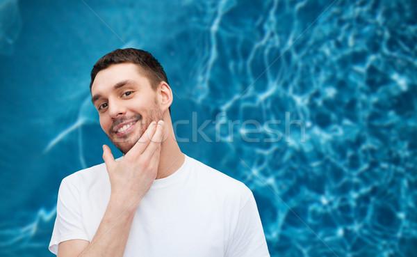 Mooie glimlachend man aanraken gezicht gezondheid Stockfoto © dolgachov