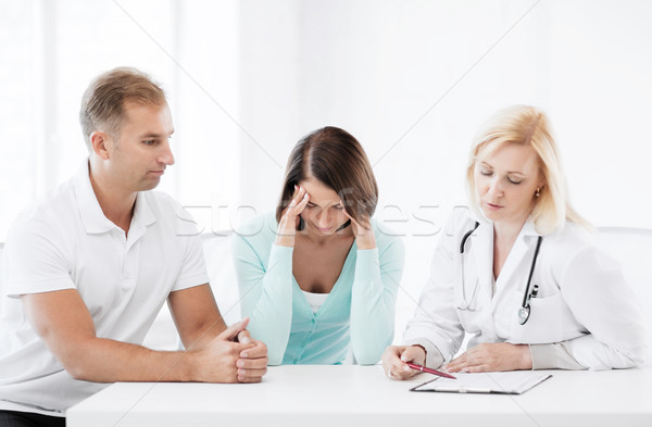 doctor with patients in cabinet Stock photo © dolgachov