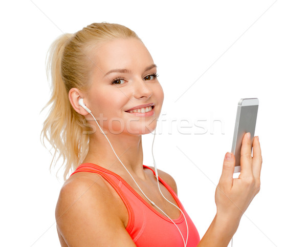 smiling sporty woman with smartphone and earphones Stock photo © dolgachov