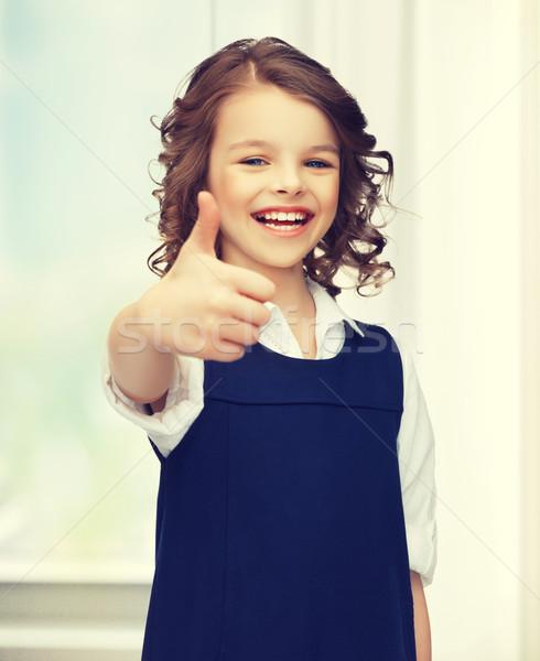 pre-teen girl showing thumbs up Stock photo © dolgachov