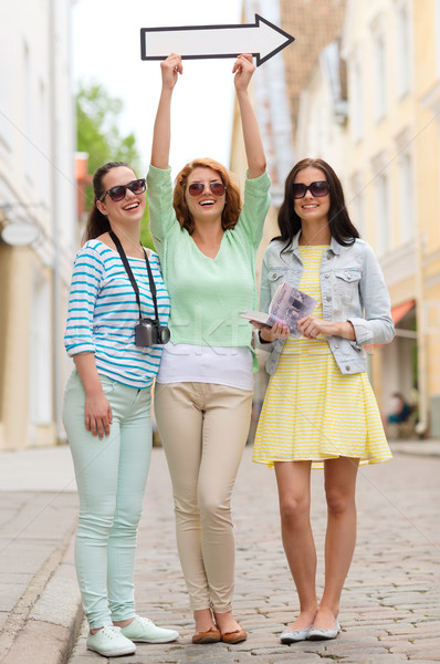 Mosolyog tinilányok fehér nyíl kint turizmus Stock fotó © dolgachov