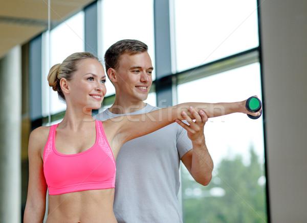 笑みを浮かべて 若い女性 パーソナルトレーナー ジム フィットネス スポーツ ストックフォト © dolgachov