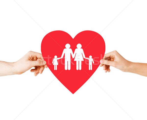 couple hands holding red heart with family Stock photo © dolgachov