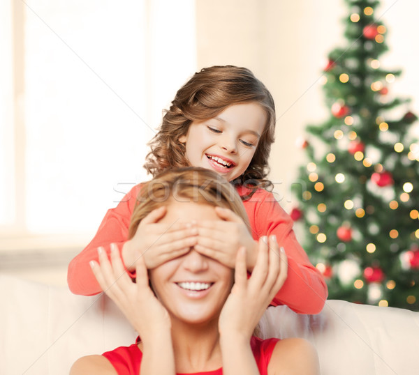 mother and daughter making a joke Stock photo © dolgachov