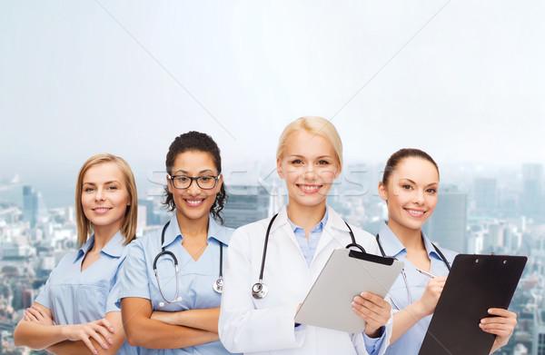 улыбаясь женщины врач здравоохранения Сток-фото © dolgachov
