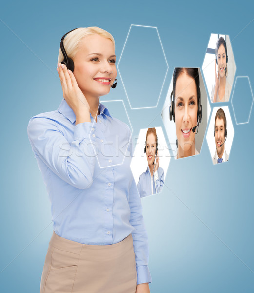 улыбающаяся женщина телефон доверия оператор бизнеса технологий Call Center Сток-фото © dolgachov