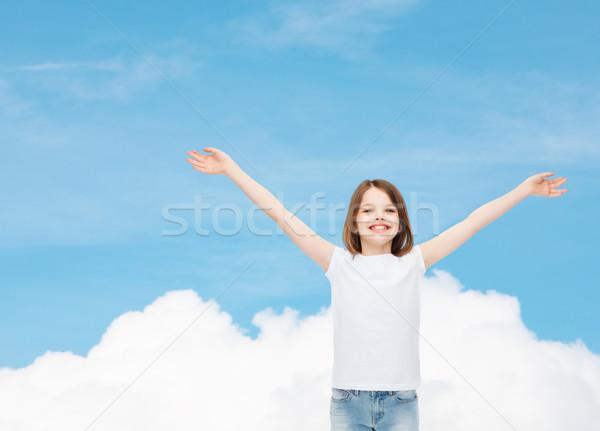 Mosolyog kislány fehér póló hirdetés álom Stock fotó © dolgachov