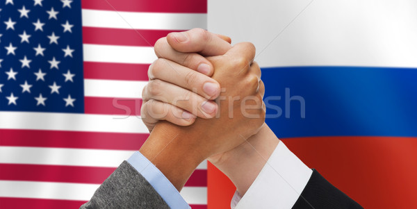 hands armwrestling over american and russian flags Stock photo © dolgachov