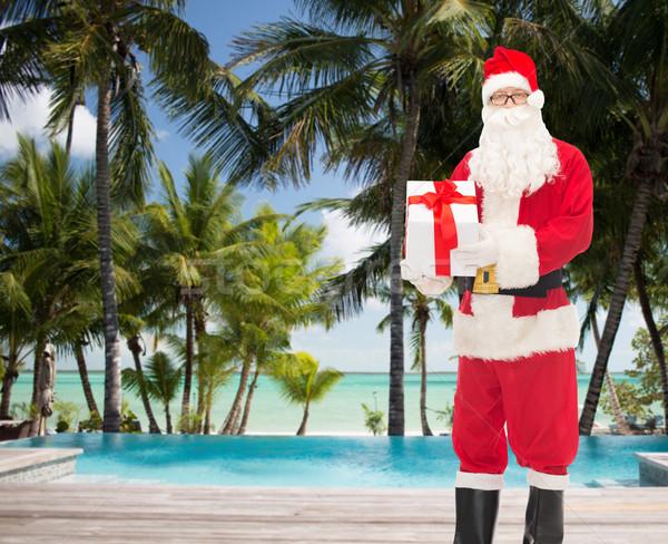 Férfi jelmez mikulás ajándék doboz karácsony ünnepek Stock fotó © dolgachov