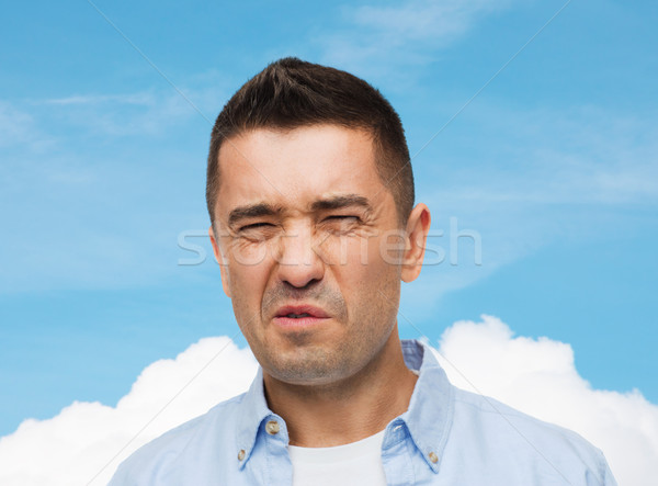 man wrying of unpleasant smell Stock photo © dolgachov